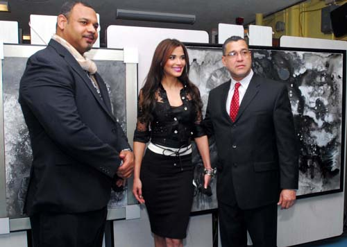 El artista Rigo Peralta, la presentadora del Canal 47, Andris