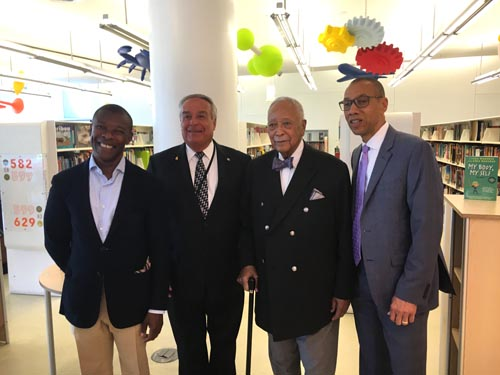 Google's Head of External Affairs for New York, William Floyd, with Queens Library Trustee the Honorable Augustus C. Agate, Mayor David Dinkins, and Queens Library President and CEO Dennis Walcott.