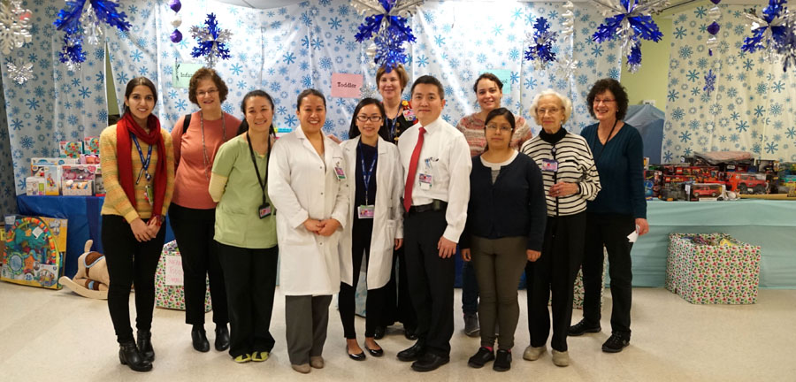 "NYC Health + Hospitals/Elmhurst's Child Life Specialists, physicians, nutritionists, volunteers, and other staff gather to organize activities for the facility's annual ""Winter Wonderland"" toy donation event for pediatric patients. Photo courtesy"
