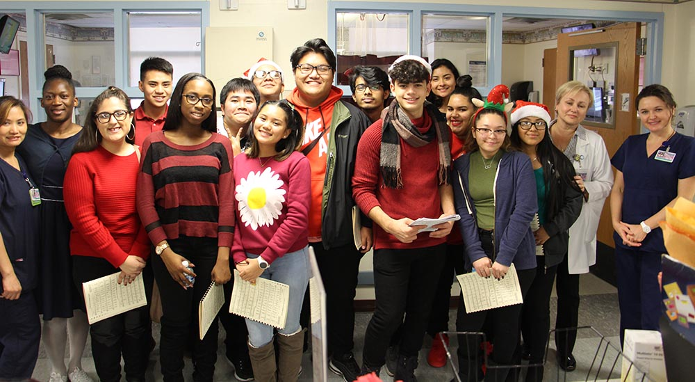 Students from William Cullen Bryant High School's choir brought the holiday spirit to staff and patients at NYC Health + Hospitals/Elmhurst during the hospital's annual tree-lighting ceremony on Dec. 4th.