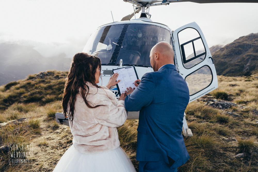 Singing the register on a helicopter in Queenstown
