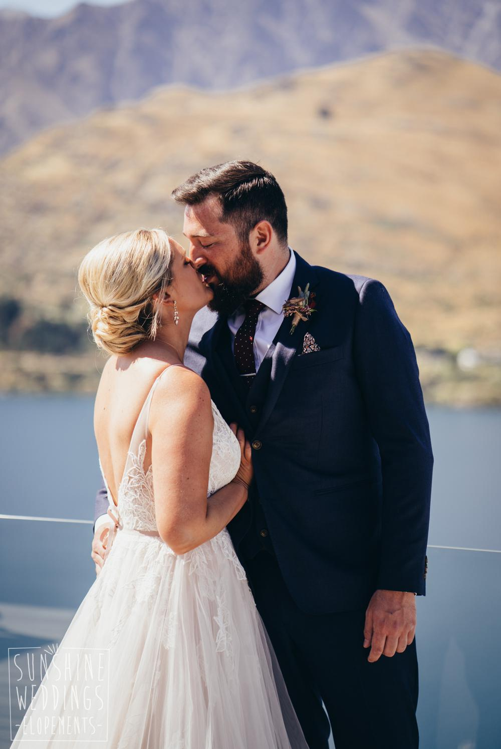 Wedding photo of bride and groom kissing