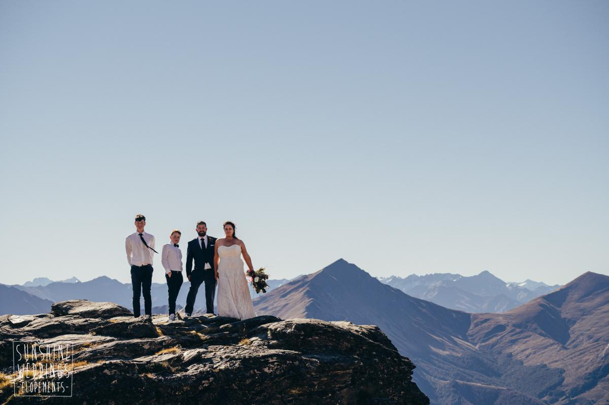 bride groom and family on the ledge mountain in Queenstown