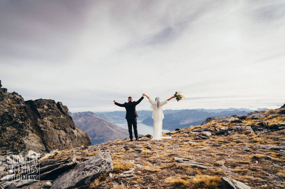 standing on remarkables for mountain wedding