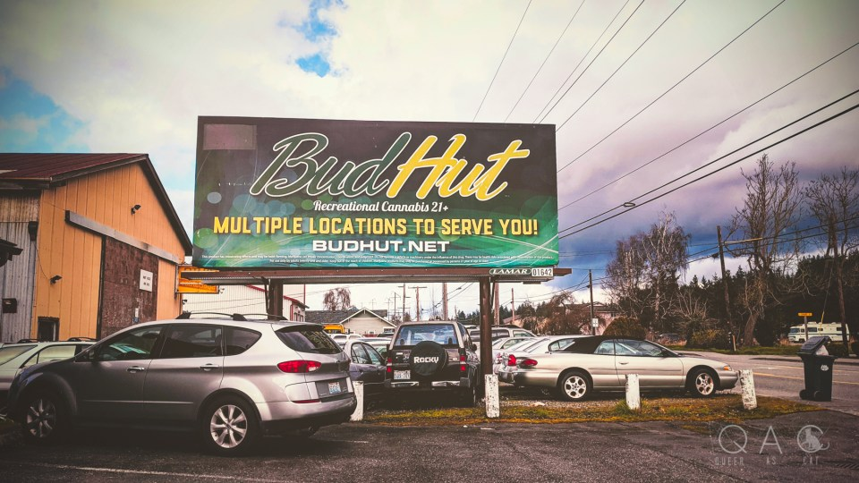 "photo: a billboard that reads ""BudHut / Recreational Cannabis 21+ / Multiple locations to serve you!"""