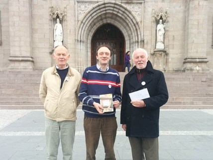 Brendan Butler, from We are Church Ireland, Dr Richard O'Leary, from Faith in Marriage Equality, and Jim O'Crowley, from Gay Catholic, at St. Patrick's Cathedral, Armagh.