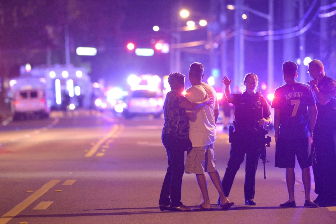 Orlando police officers and bystanders outside of shooting at a nightclub in Orlando, FL, on Sunday. Photo by Phelan M. Ebenhack.