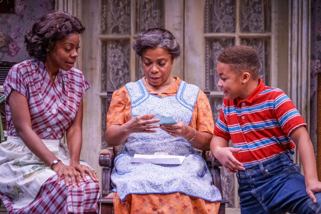 Mia Ellis (Ruth Younger), Denise Burse (Lena Younger), and Jalani Clemmons (Travis Younger) in A Raisin in the Sun at Seattle Repertory Theatre. Photo: Alan Alabastro.