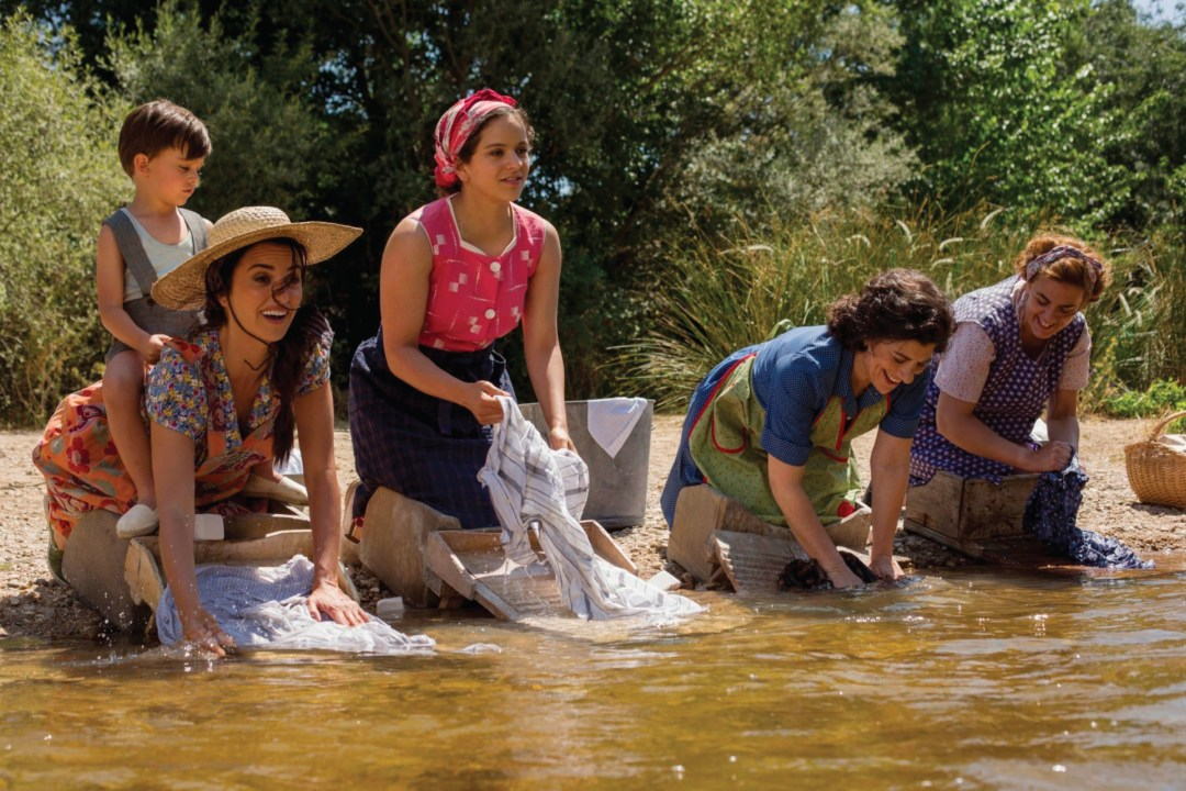 Almodóvar recreates an early childhood memory, in which his mother, played by Cruz, washes sheets in the river.