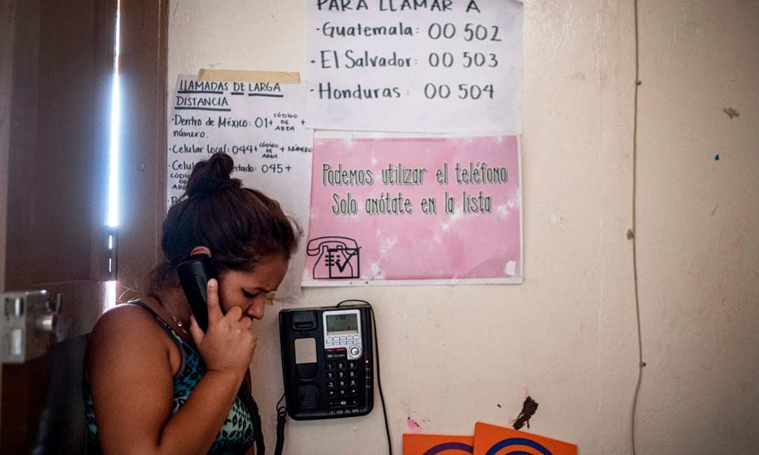 A participant in T'ja Xuj makes a free phone call home to her family.