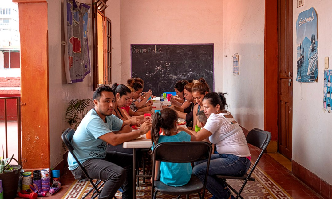 The women and their children, plus volunteers, share a meal each Sunday.