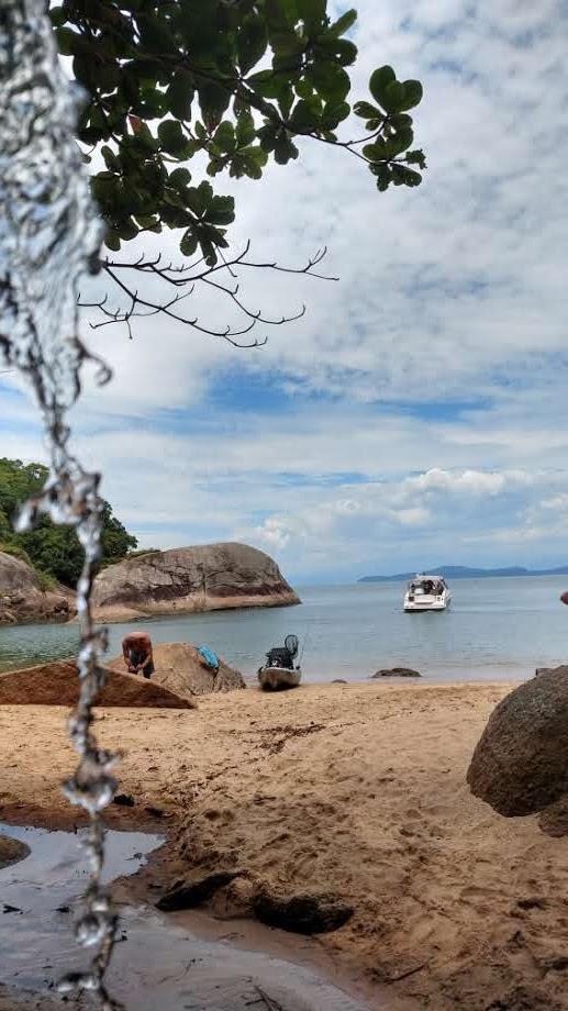 Canoa havaiana no Guaruja passeio a praia isolada 3 foto Turelo