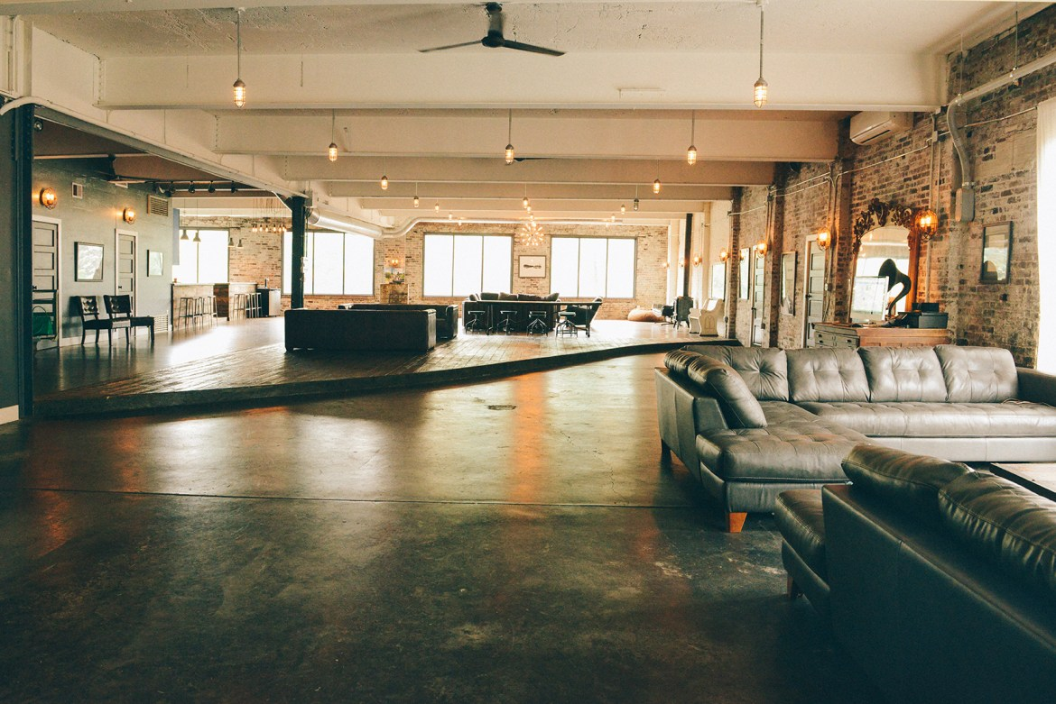 A Dedicated Couple Restores America's First Indoor Car Dealership into an Industrial Home 01