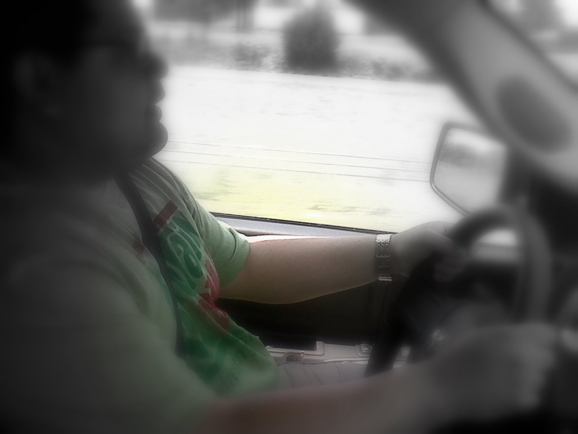 """Blurred photo of man driving. """"How I Learned About My Unfair Expectations in My Marriage"""" quemeanswhat.com"""