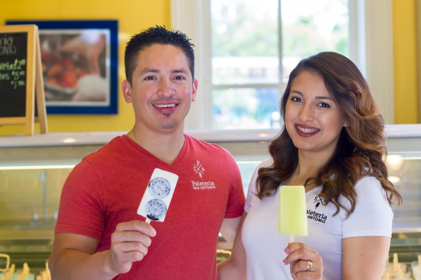 Male and Female owners of Paleteria stand holding paletas.