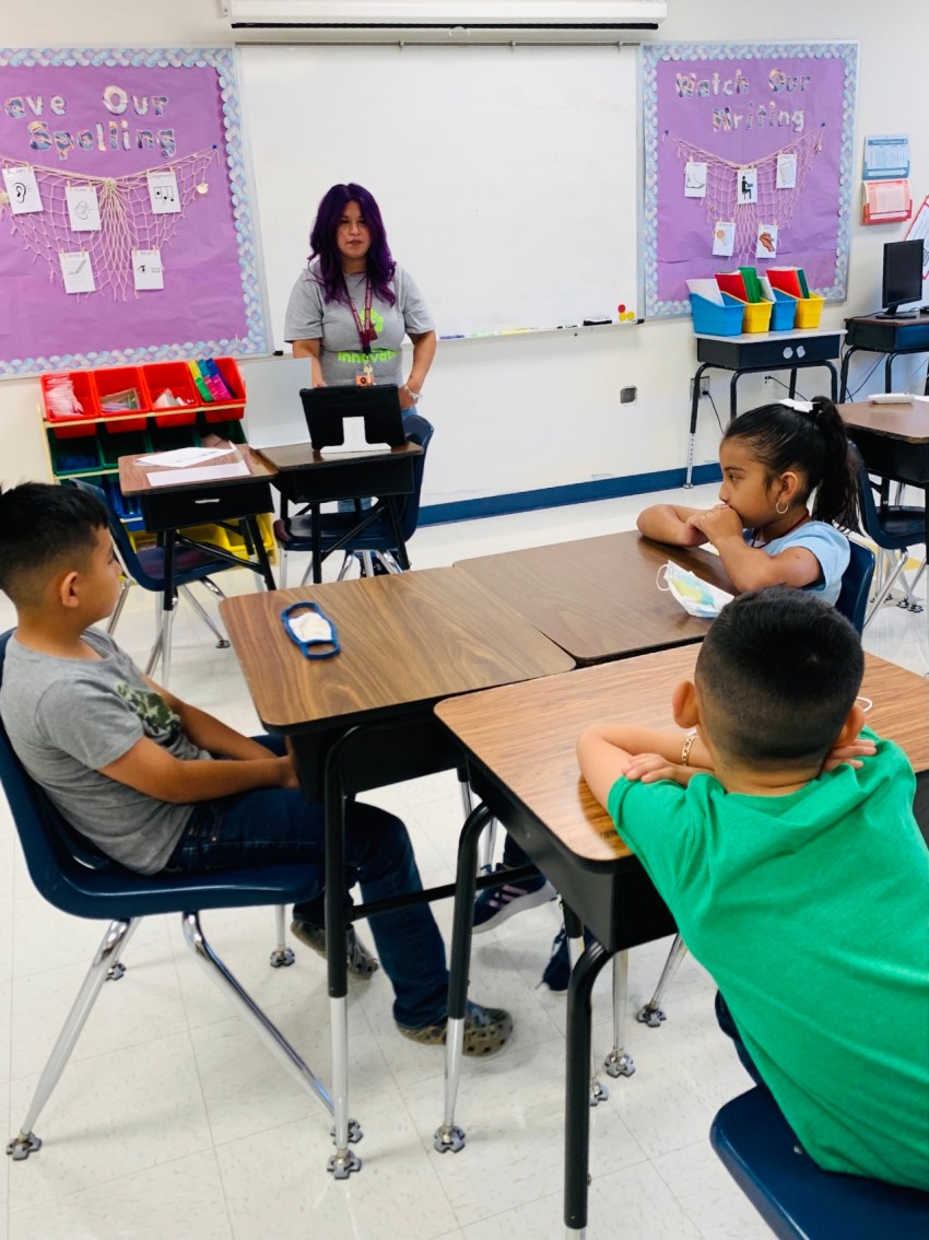 Danielle Navarro is the Reading Interventionist/504/ESL Coordinator at Lighthouse Public Schools. Danielle stands in front of her class room.