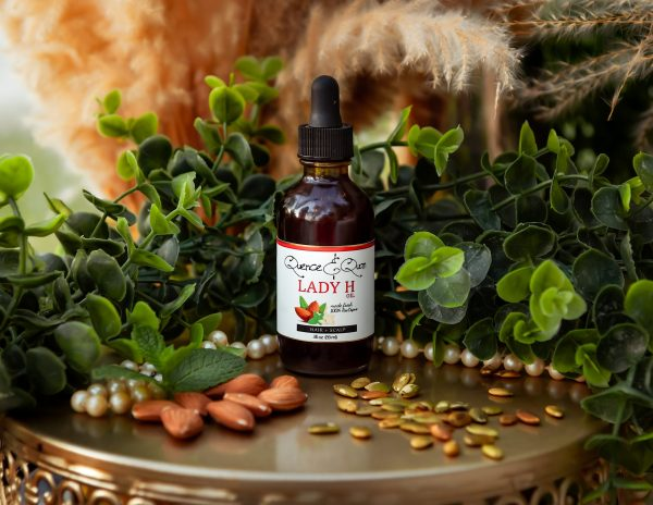 Lady H growth serum surrounded with fresh pumpkin and almond seeds