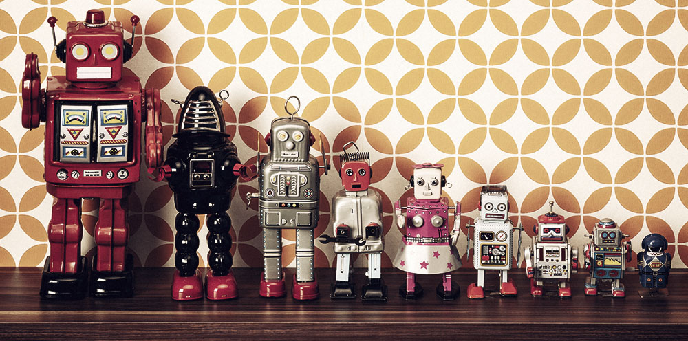 Retro style photography of a group of tin toy robots on a shelf.