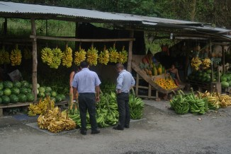 Our bus drivers from Guayaquil stop and comtemplate their prospective purchase...no hurry!