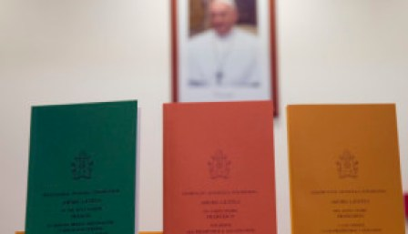 """Copies of the post-synodal apostolic exhortation ' Amoris Laetitia ' (The Joy of Love) document are on display prior to the start of a press conference, at the Vatican, Friday, April 8, 2016. Pope Francis has insisted that individual conscience be the guiding principle for Catholics negotiating the complexities of sex, marriage and family life in a major document released Friday that repudiates the centrality of black and white rules for the faithful. In the 256-page document """"The Joy of Love,"""" released Friday, Francis makes no change in church doctrine. (AP Photo/Andrew Medichini)"""