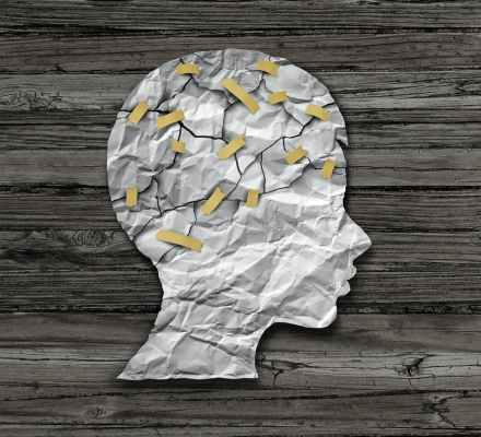 A paper head taped back together representing Complex post traumatic stress disorder (CPTSD)