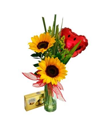 florero con rosas y girasoles