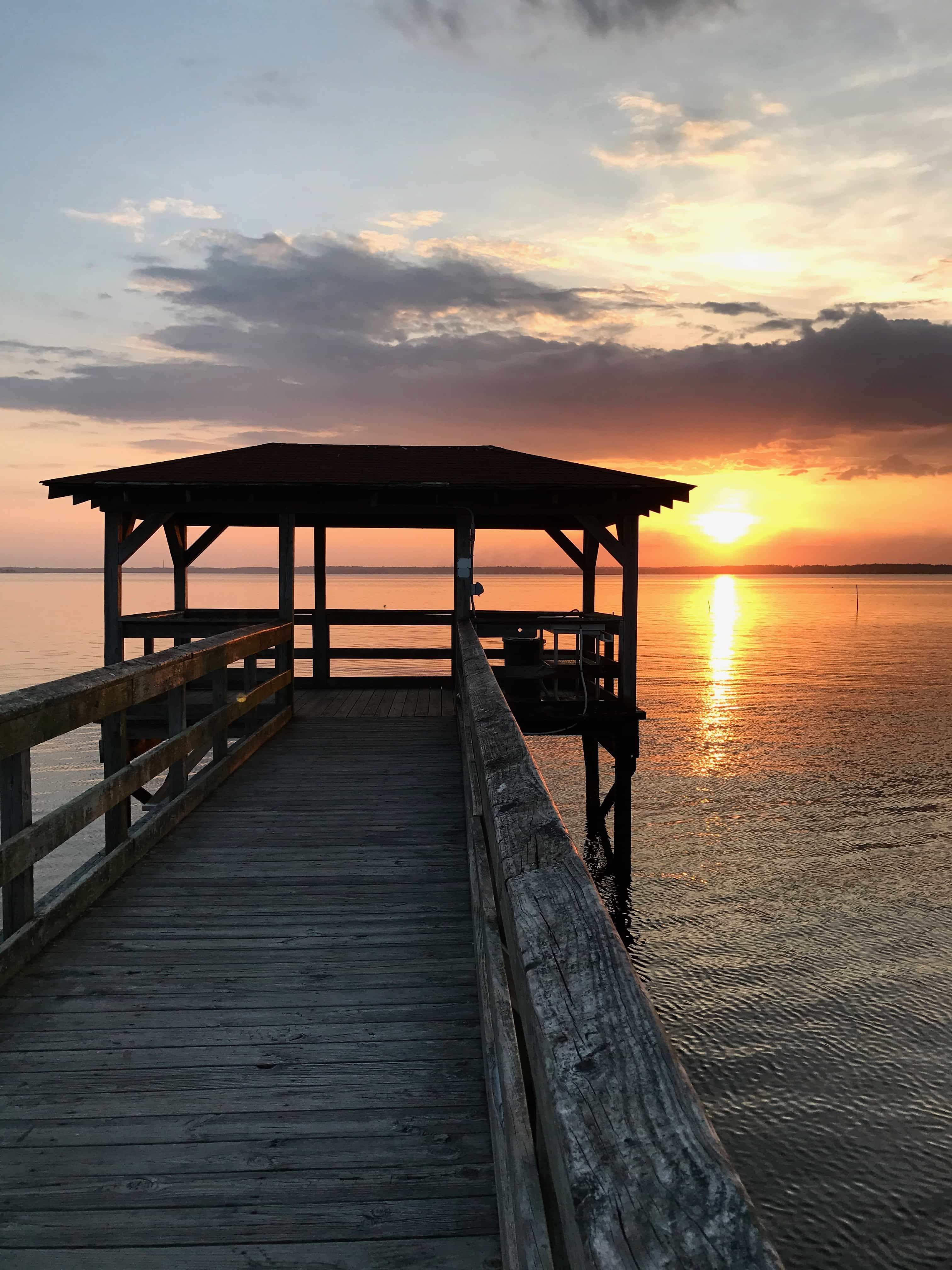 gazebo and pier on the sound at sunset