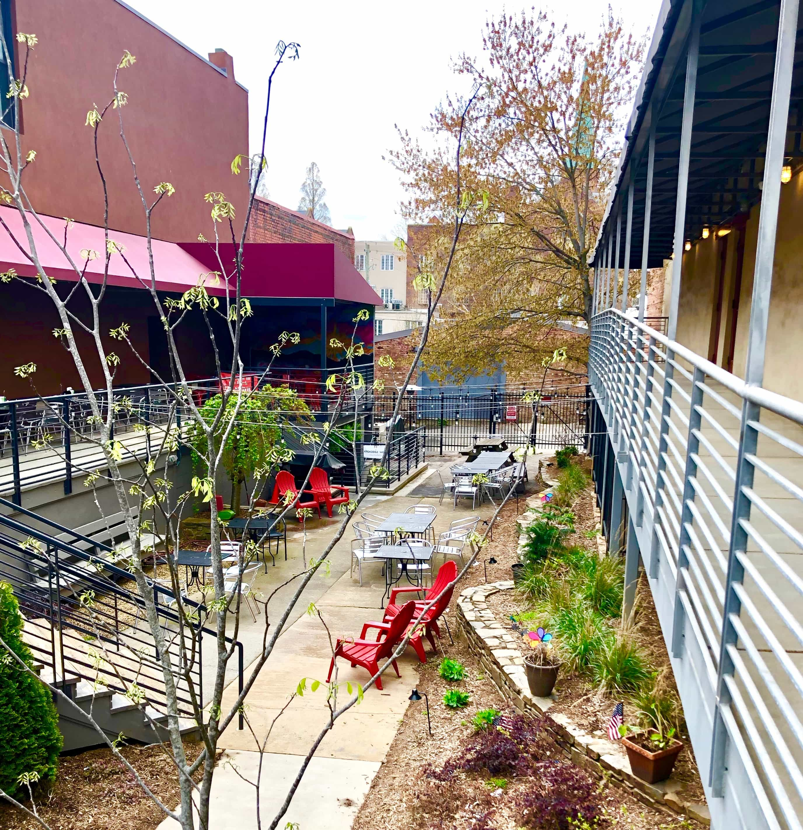 the garden seating area outside of Manicomio Pizza parlor in Asheville, NC