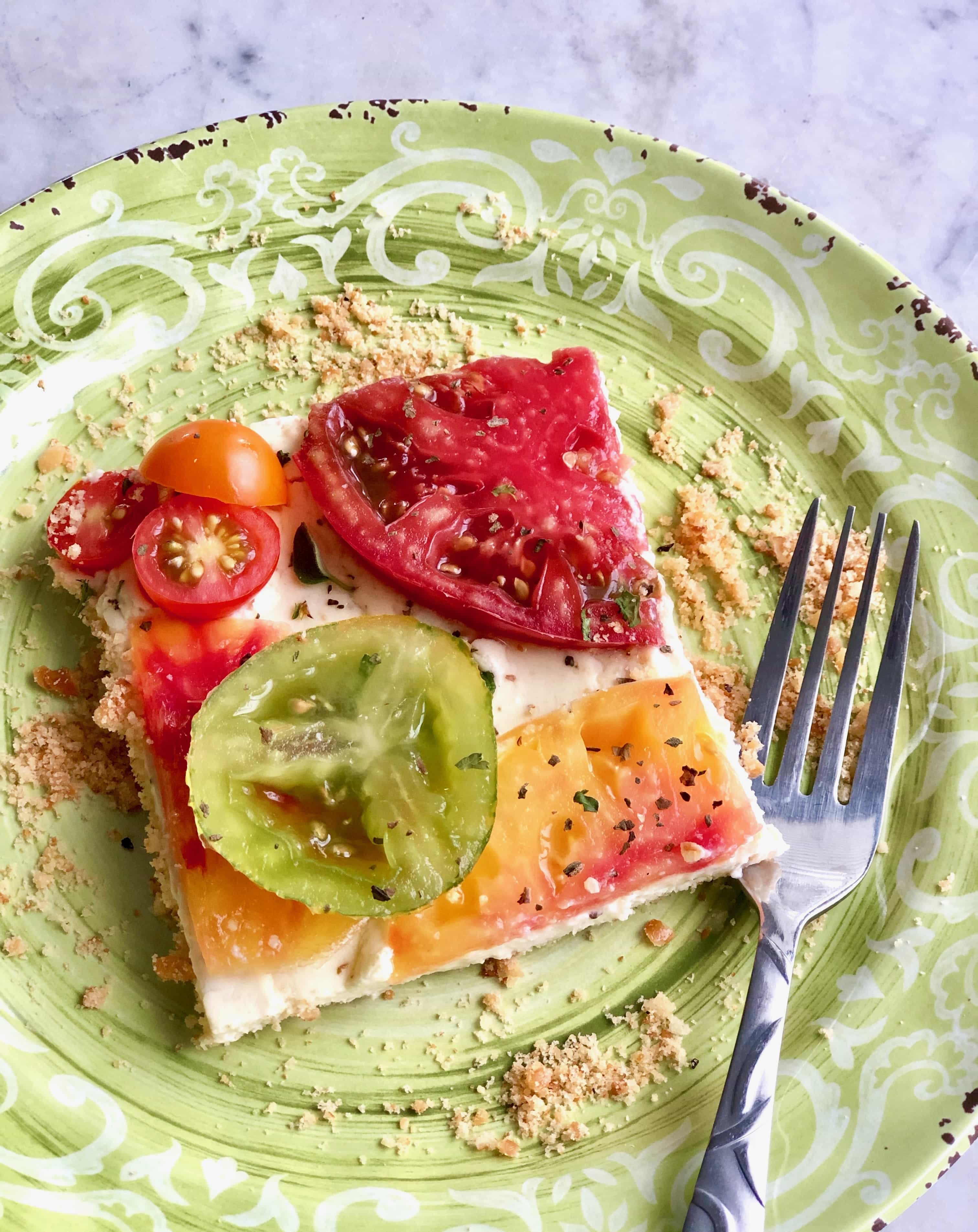 slice of tomato tart on a green plate