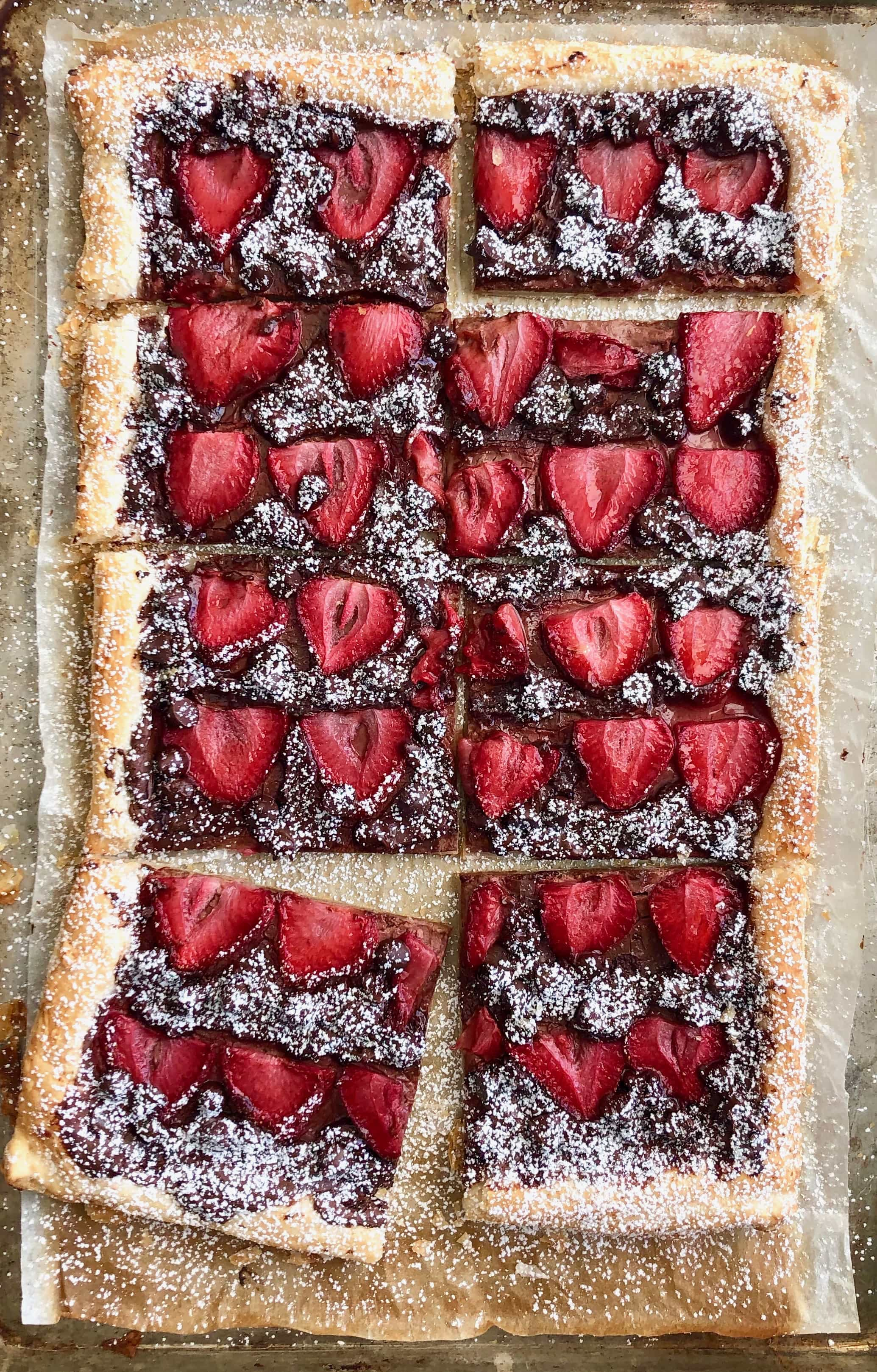 chocolate strawberry tart on a sheet pan