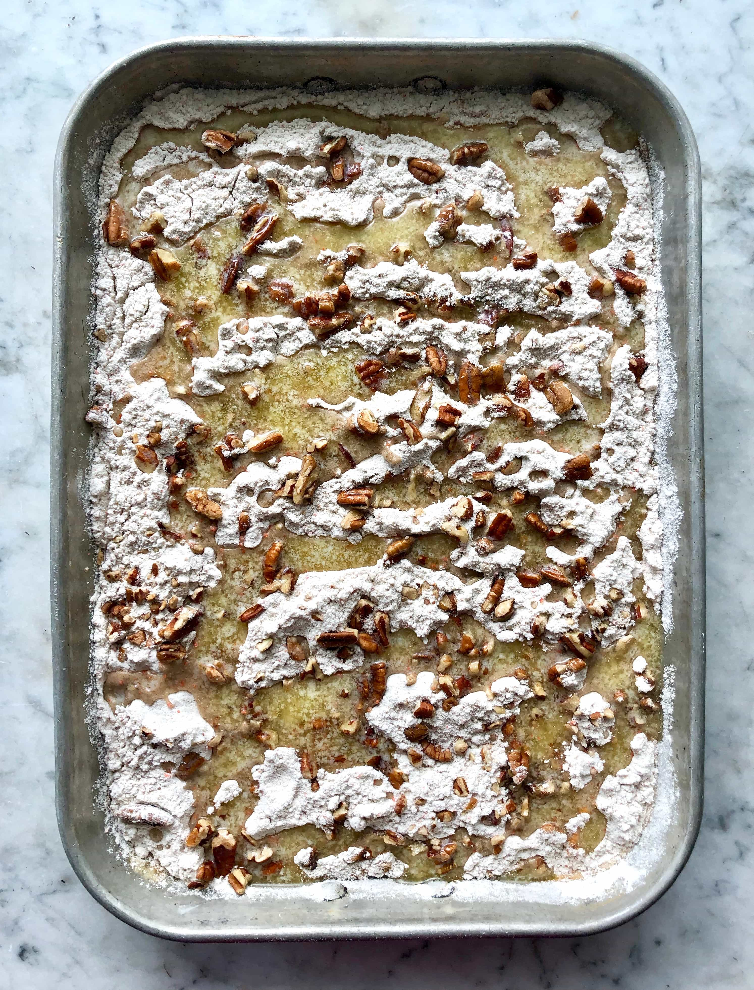 pumpkin spice flip cake in a sheet cake pan swirled with butter