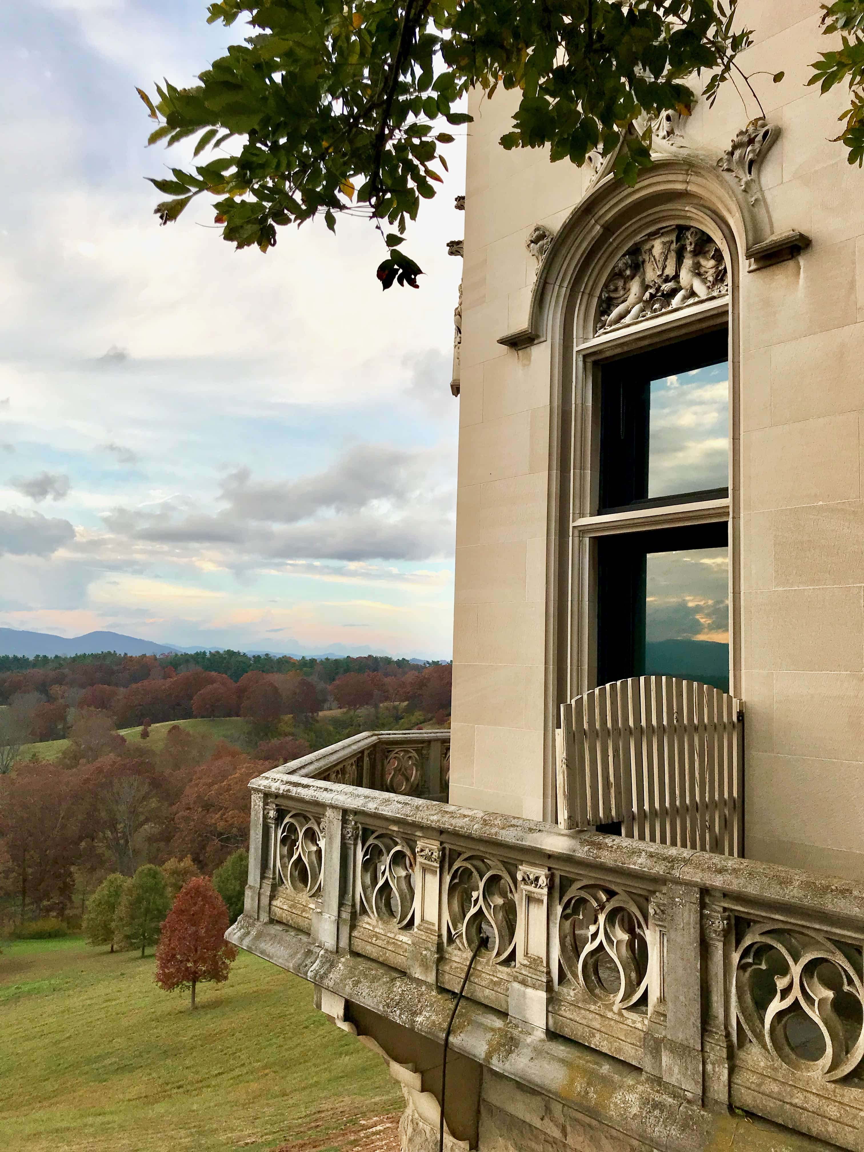 reflection of mountains in window at biltmore house