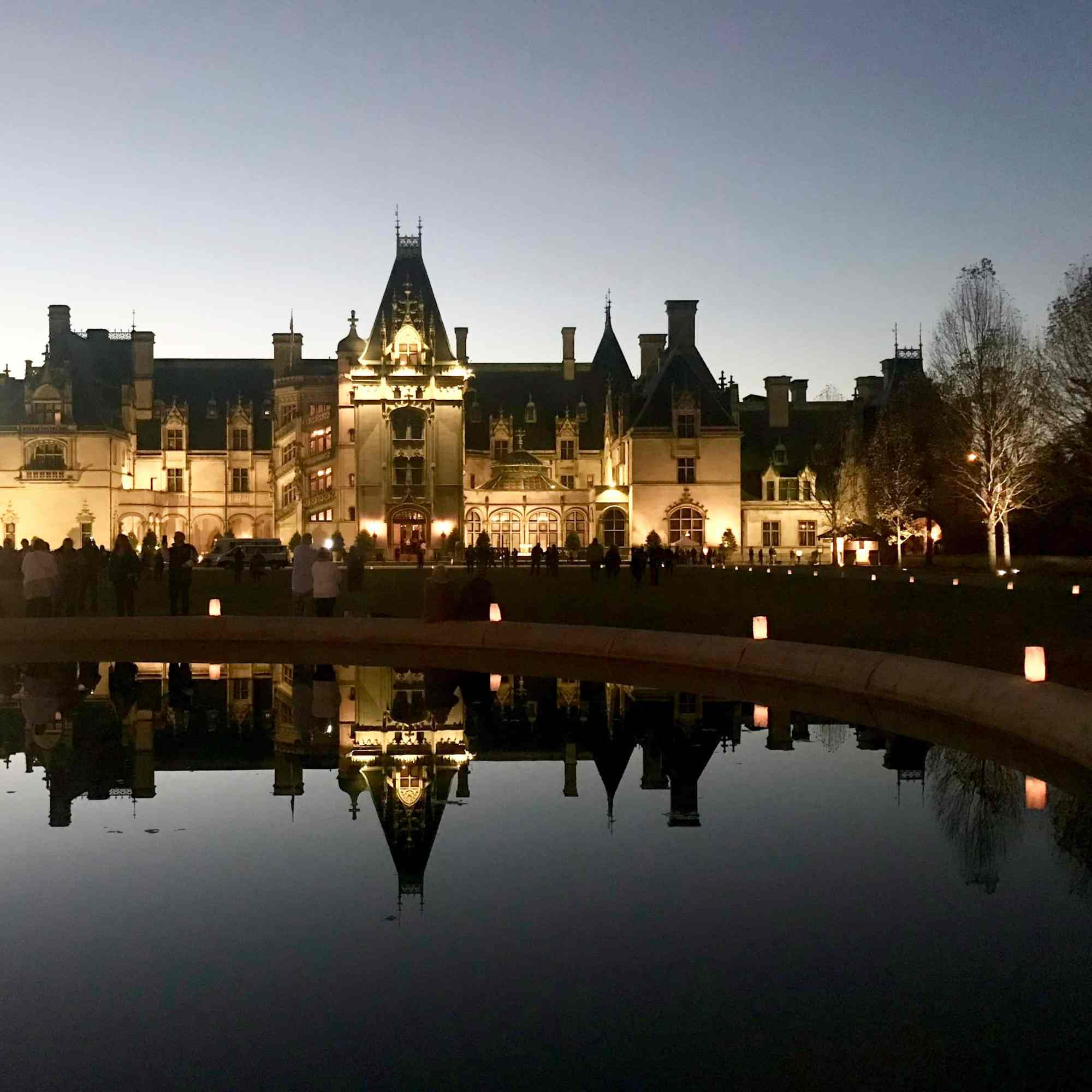 Biltmore House at sunset with reflection of house in pool