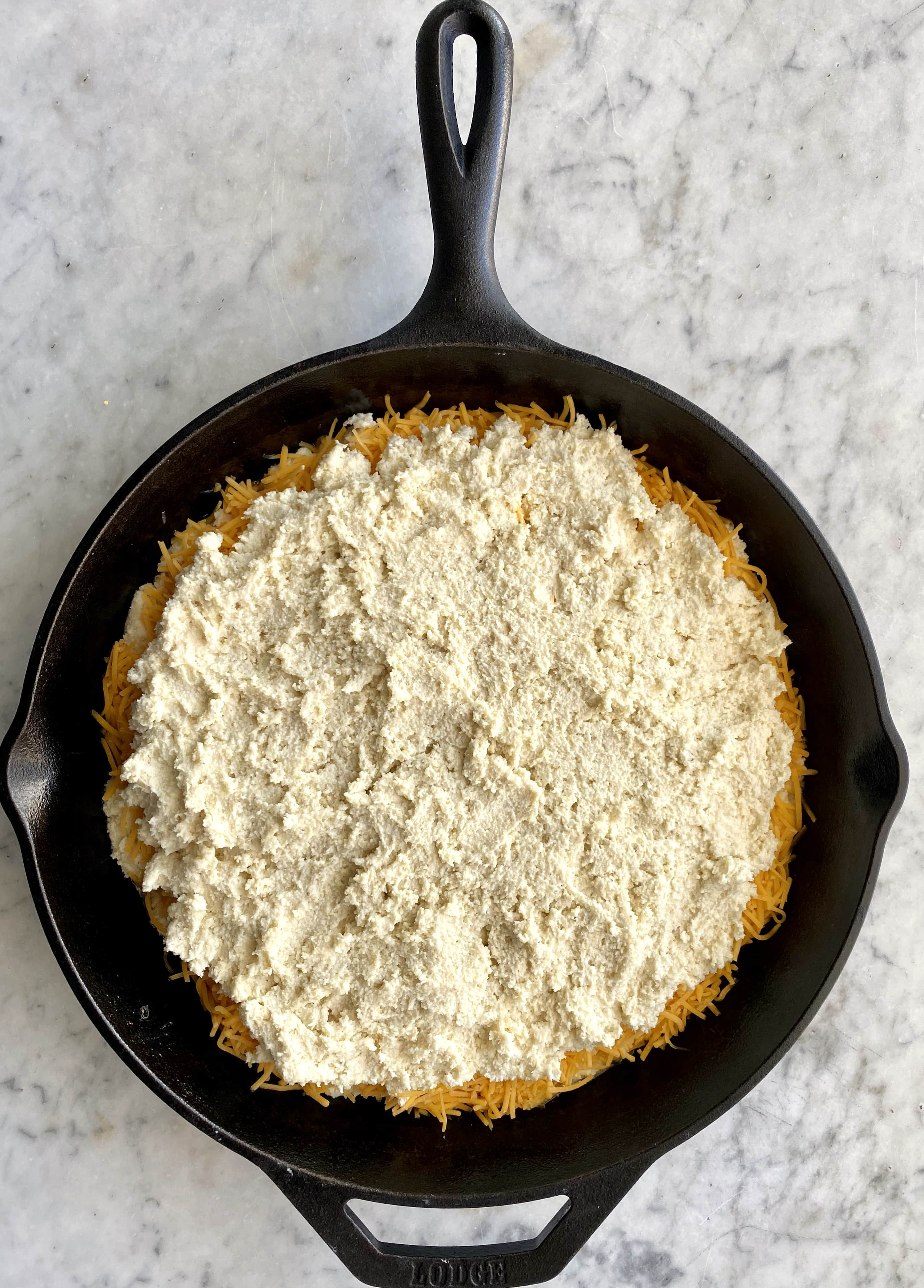 cheesy skillet cornbread in a cast iron skillet