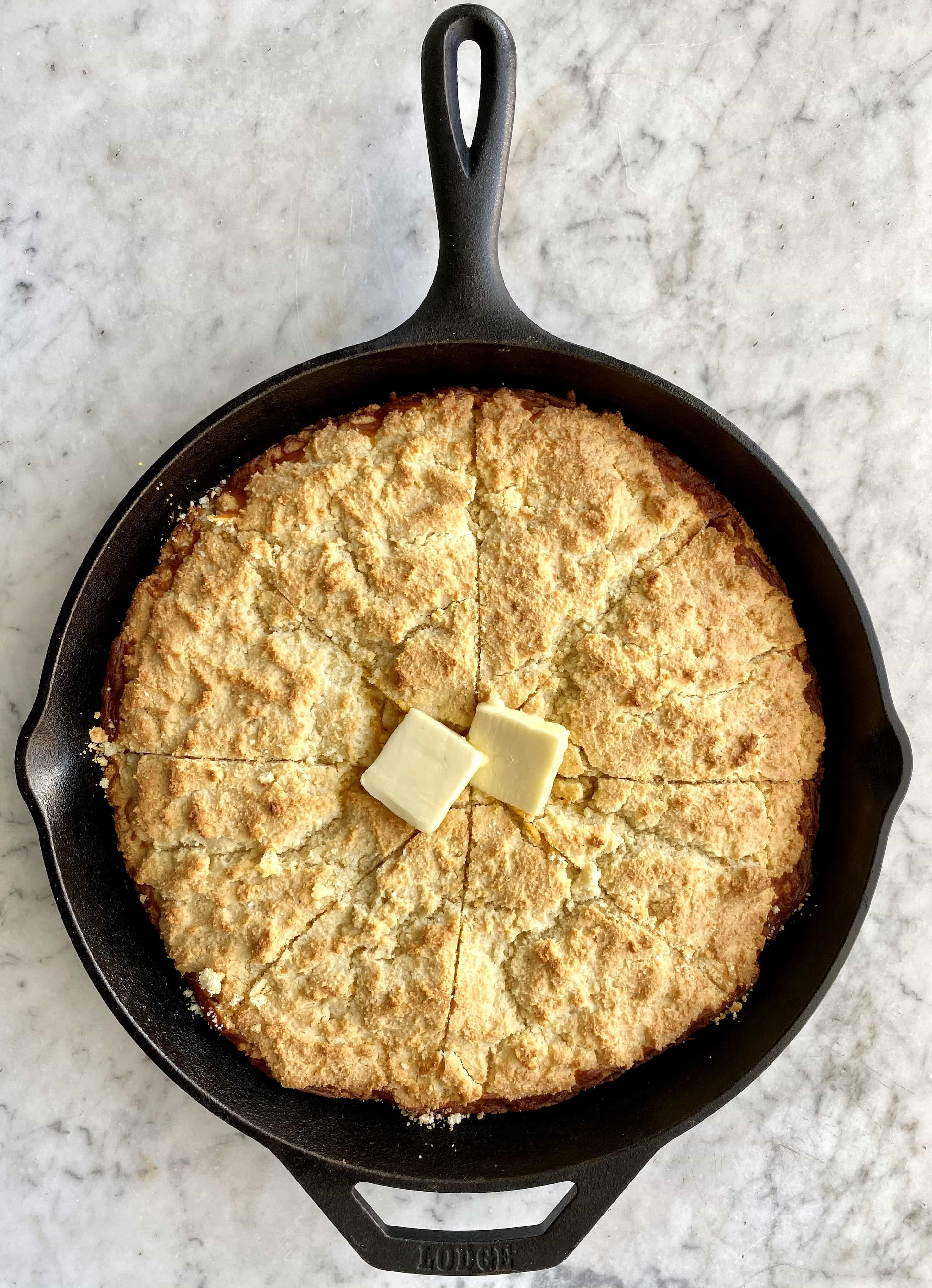southern cheesy cornbread in a cast iron skillet