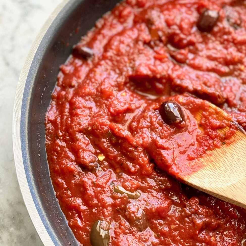 sun dried tomato marinara sauce in a skillet