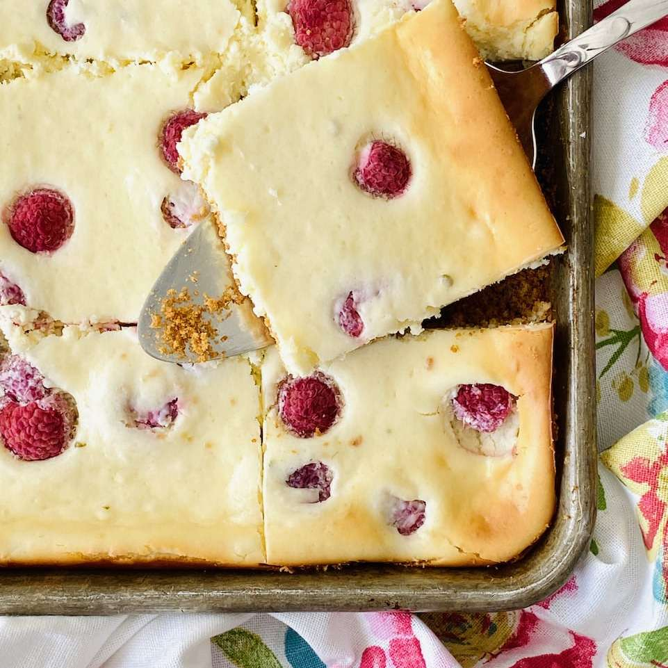 image of raspberry cheesecake squares on a floral towel