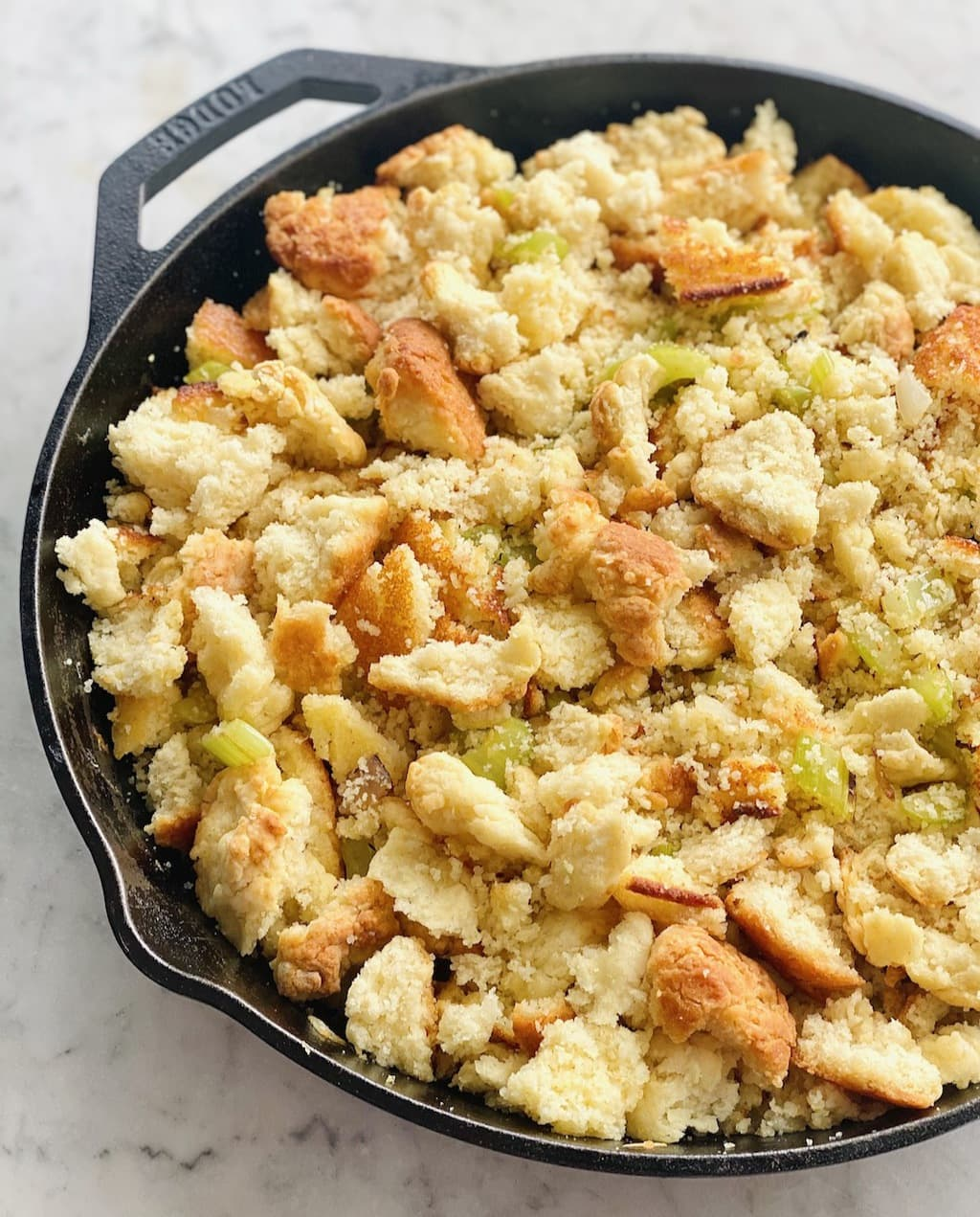crumbles of cornbread and biscuits mixed with celery and onions.