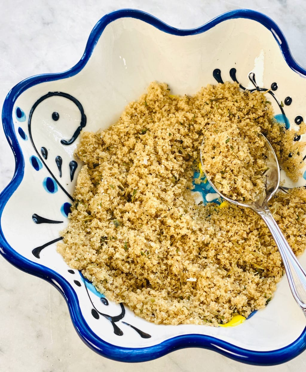 topping of brown sugar and spices in a blue rimmed bowl.