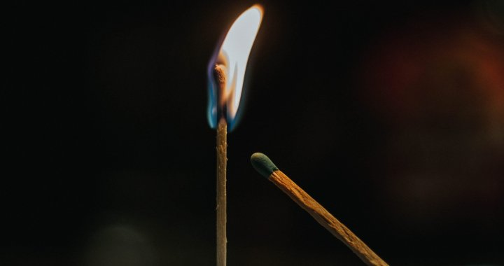 Two matches slowly burn.