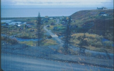 This is what Ninilchik looked like in 1953.  Please notice the lack of pavement on the road.  You could still land a plane on the beach, or camp there under a parachute tent.