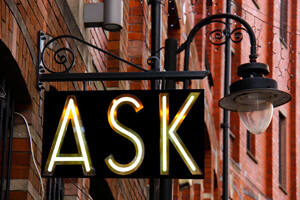 street sign that says ask
