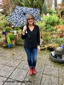 Image of LIz in red boots, cuffed jeans and black blouse