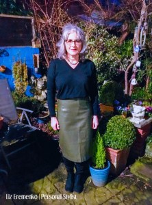 Image of LIz in olive green pleather skirt, black sweater and black boots