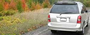Mini Van on Dirt Road