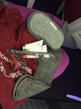 Contents of the amenities kit! Eye mask, socks, toothbrush and paste, earplugs, pen, moisturizer, chapstick