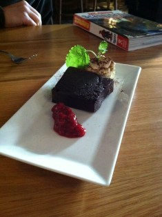 Dark chocolate cake with rhubarb garnish