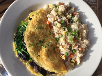 Spinach and mushroom omelette with fried rice