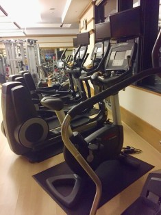 Variety of Cardio, including a bottle of water and towel at each machine