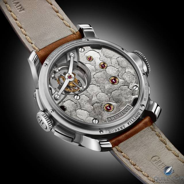 The back of the watch is decorated with profiles of those involved in the Greubel Forsey Art Piece 2 Edition 1 Filliou project, a reference to Filliou's Couvre-Chef(s)-D'oeuvre(s), depicting a bowler hat containing the works of 14 artists